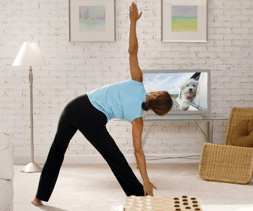 Woman exercising while watching TV.